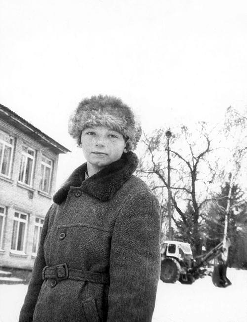 Boy in Front of School